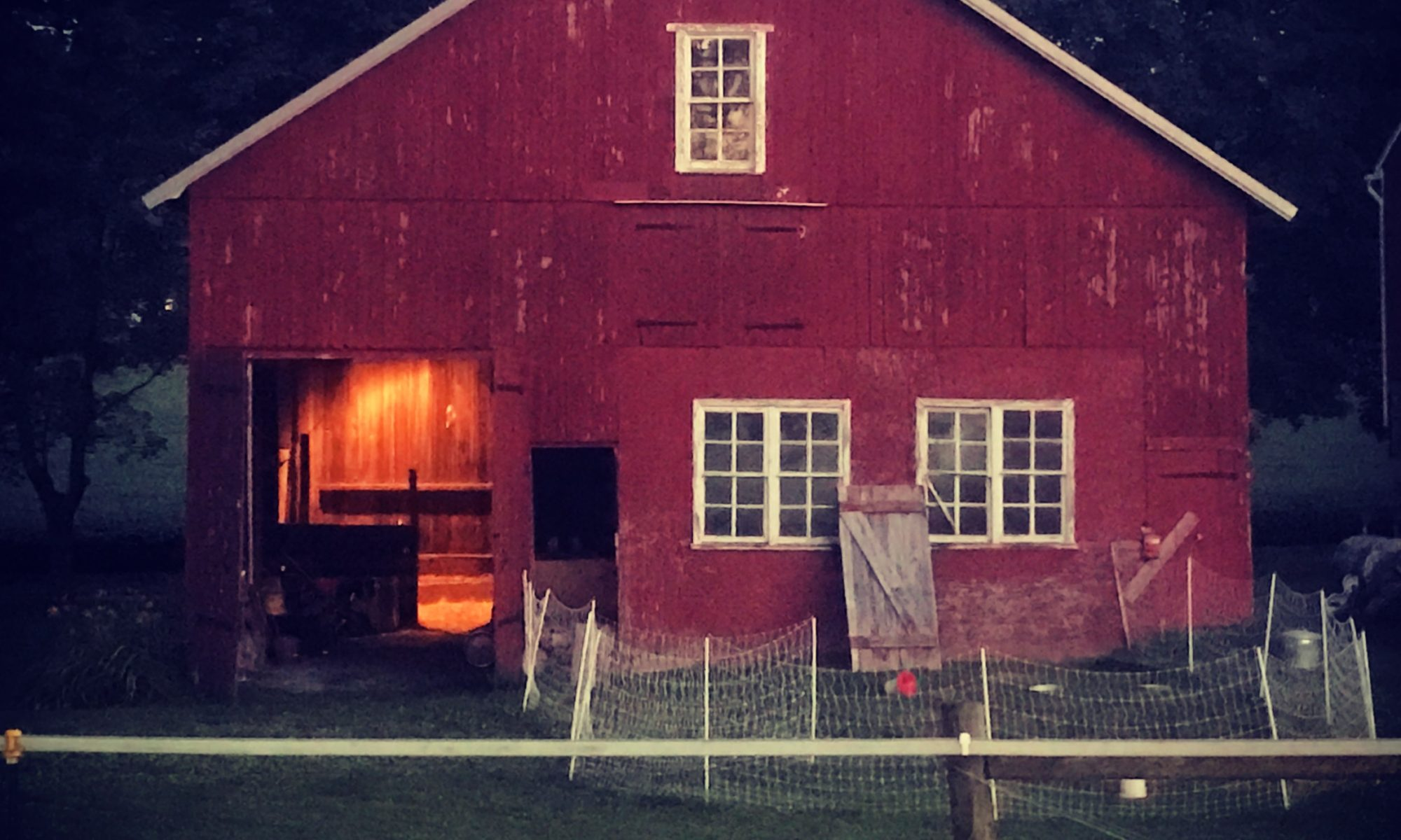 Old PA barn with lights on inside